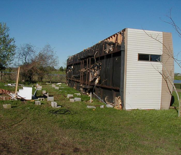 A mobile home turned over by a storm