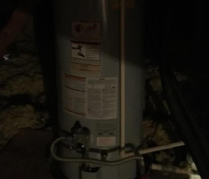 Water Damage Coppell, TX - Hot Water Heater Busts in the Attic Causing Several Rooms to be Affected