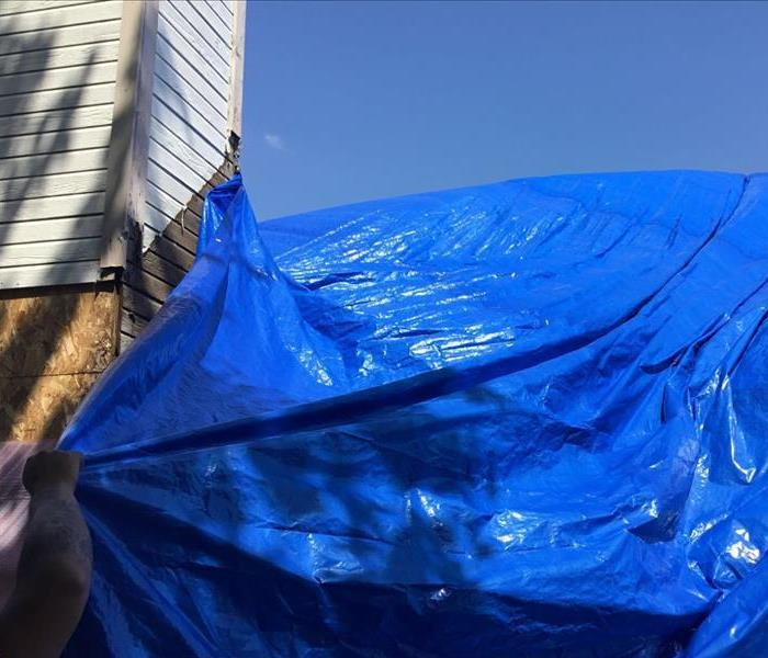Water Damage Princeton, TX water damage caused by a roof tarp